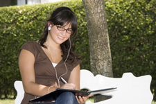 Portrait of a young woman studying outdoor copyright reflektastu